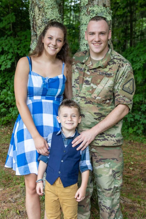 Tyler in military uniform taking a family photo.