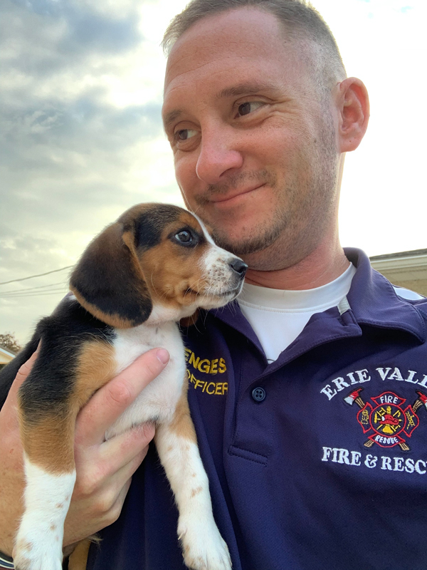 Alex Menges with beagle puppy.